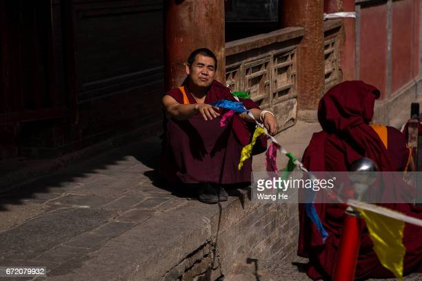 Tibetan buddhist monks talk in the courtyard of the Kumbum Monastery on April 23 2017 in Xining Qinghai Province Kumbum was founded in 1583 in a...