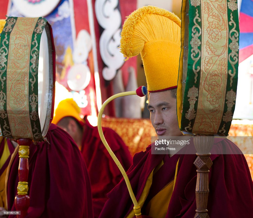 Tibetan Buddhist monks with musical instrument during the 1st day of Tibetan new year 'Losar' at Tsugla Khang Temple. Tibetan Buddhist Monks chant the Tibetan Mantras during the 1st day of Tibetan new year 'Losar' at Tsugla Khang Temple. Hundred of Tibetan Buddhist Monks and Tibetan in exile including members of the Tibetan parliament (Kasag) participated in this prayer.