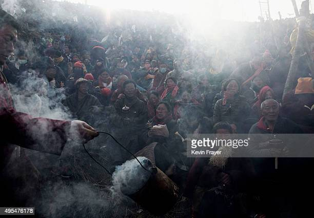 Tibetan Buddhist nomads are blessed with juniper smoke as they pray at the annual Bliss Dharma Assembly at the Larung Wuming Buddhist Institute on...
