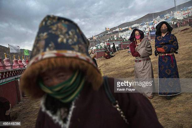 Tibetan Buddhist nomads leave following a chanting session as part of the annual Bliss Dharma Assembly at the Larung Wuming Buddhist Institute on...