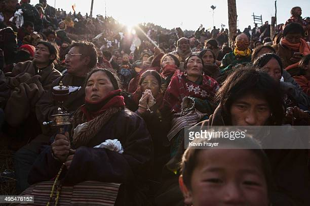 Tibetan Buddhist nomads pray during the annual Bliss Dharma Assembly at the Larung Wuming Buddhist Institute on November 1 2015 in Sertar county in...