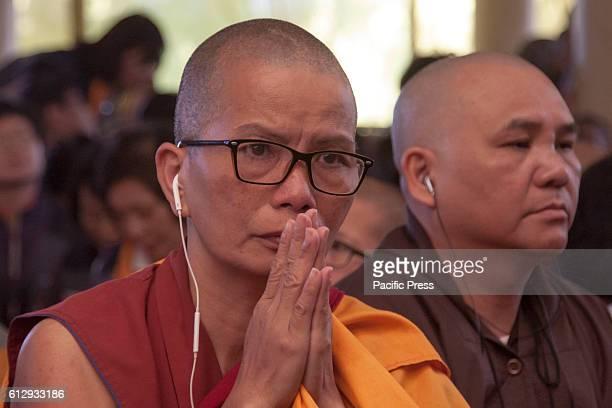 Tibetan buddhist nun during the long life prayer for Tibetan Spiritual Leader the Dalai Lama at Tsugla Khang Temple Mcleodganj Dharamshala on...