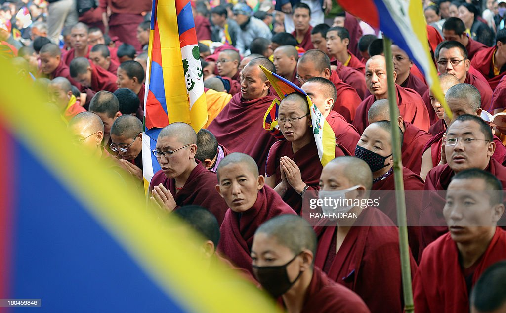 Tibetan Buddhist nuns, monks and activists pray during a protest rally in New Delhi on February 1, 2013. The Tibetan government in exile launched a Solidarity with Tibet Campaign 2013, as Tibetans continue to self-immolate calling for freedom in Tibet. Thousands of Tibetans are on a protest in the Indian capital as part of a renewed drive to bring global pressure on China and highlight a string of self-immolations in their homeland.