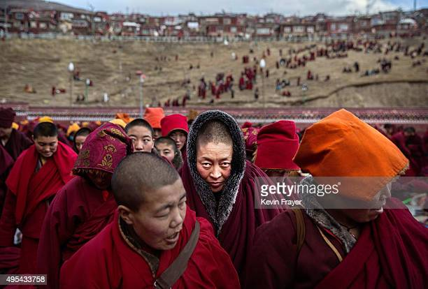 Tibetan Buddhist nuns stand following a chanting session as part of the annual Bliss Dharma Assembly at the Larung Wuming Buddhist Institute on...