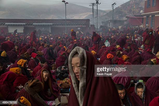 Tibetan Buddhist nuns try to keep warm in subzero temperatures before a chanting session at the annual Bliss Dharma Assembly at the Larung Wuming...