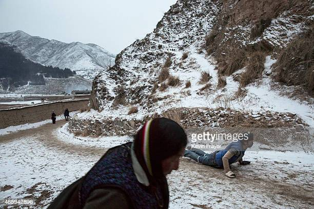 Tibetan Buddhist prostrates while performing Kora during a pilgrimage for Monlam or the Great Prayer rituals on March 4 2015 at the Labrang Monastery...