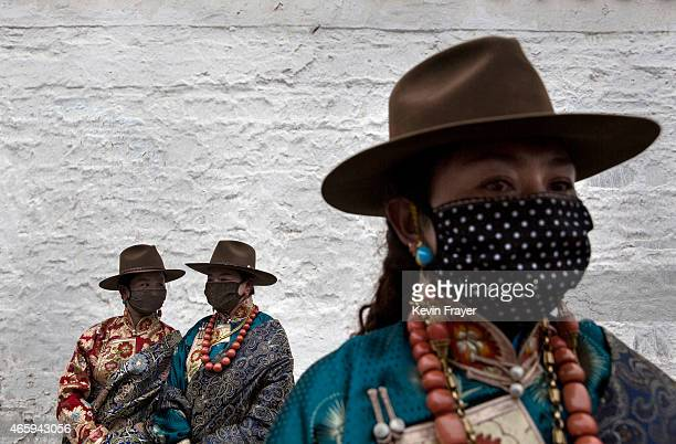 Tibetan Buddhist women wait to take part during Monlam or the Great Prayer rituals on March 4 2015 at the Labrang Monastery Xiahe County Amdo Tibetan...