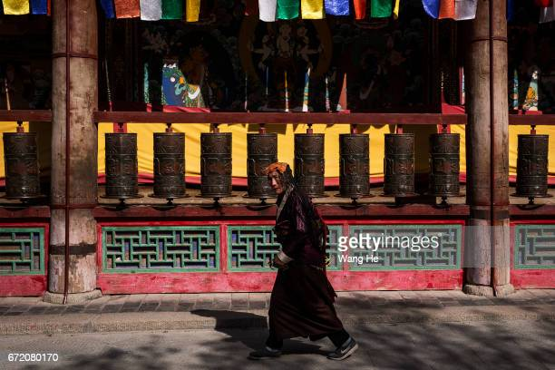 Tibetan buddhist worshipper walk around the in the courtyard of the Kumbum Monastery on April 23 2017 in Xining Qinghai Province Kumbum was founded...