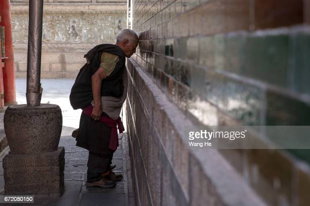 Tibetan buddhist worshippers walk around the in the courtyard of the Kumbum Monastery on April 23 2017 in Xining Qinghai Province Kumbum was founded...