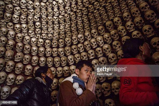 Tibetan Buddhists visit a shrine with fake skulls at the sky burial site near the Larung Wuming Buddhist Institute on October 31 2015 in Sertar...