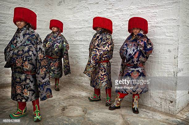 Tibetan Buddhists wear traditional clothing as they wait to take part in a procession during Monlam or the Great Prayer rituals on March 4 2015 at...