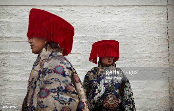 Tibetan Buddhists wear traditional clothing as they wait to take part in a processionduring Monlam or the Great Prayer rituals on March 4 2015 at the...