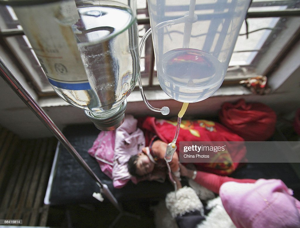 A Tibetan child receives an intravenous drip at a pediatric section of the Ermeng Township Hospital on December 9, 2005 in Tianjun County of Qinghai Province, China. Local health departments and hospitals have stepped up surveillance against influenza, tracheitis, pneumonia and other epidemic diseases as influenza season arrives during winter period.