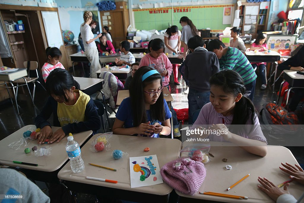 Tibetan children learn to combine colors during an after-school program for asylum immigrants run by the International Rescue Committee (IRC) on April 25, 2013 in the Queens borough of New York City. The after-school program held at P.S. 199 consists of homework help and visual art instruction for Tibetan children in grades 2 through 4. The IRC is a non-profit humanitarian aid organization that aids refugees and survivors of international conflict. They assist new arrivals, many of whom come from refugee camps and war zones, to adjust to American society after being granted refugee status and invited by the U.S. government to live in the United States. The IRC also assists refugees through the immigration and naturalization process to become U.S. citizens.