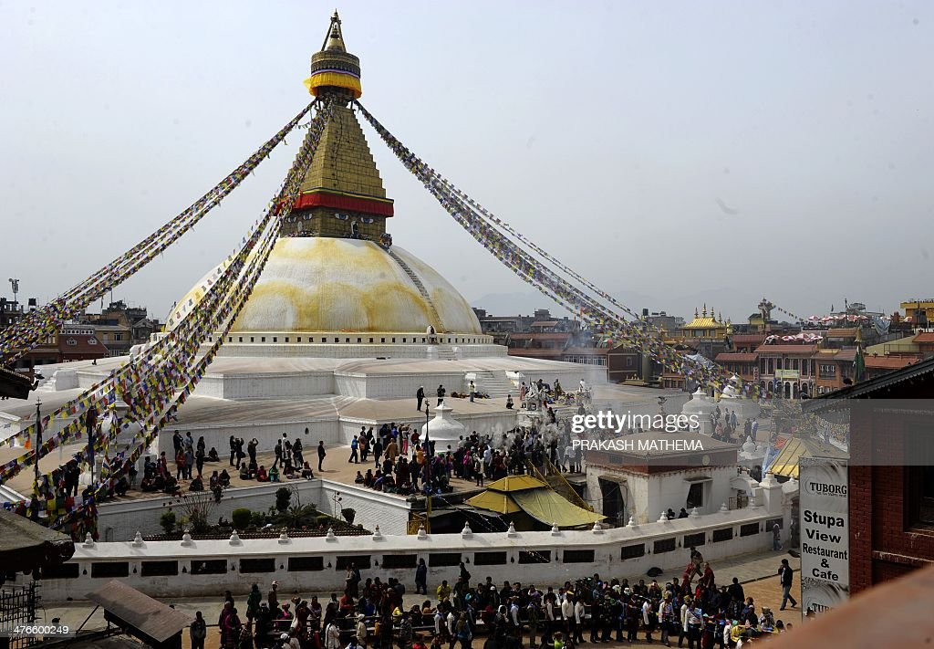 Tibetan community gather and throw flour at the Boudhanath Stupa during celebrations marking the third day of Losar Tibetan New Year in Kathmandu on...