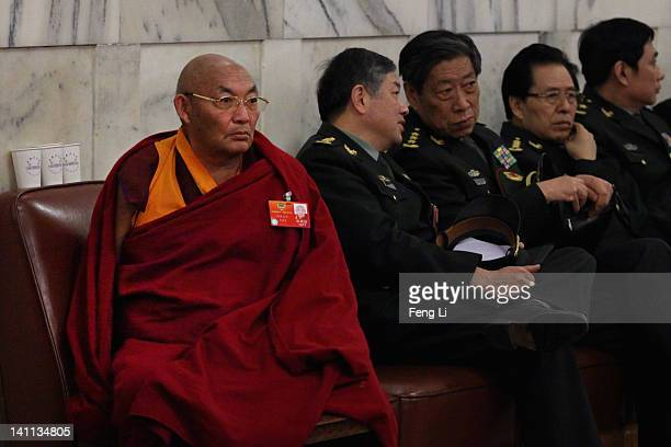 Tibetan delegate and Chinese military delegates arrive at The Great Hall Of The People before the fourth plenary meeting of the National People's...