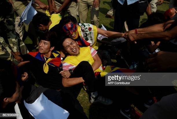 Tibetan exile activists shout slogans during a protest outside the Chinese embassy in New Delhi on October 18 2017 Members of the Tibetan Youth...