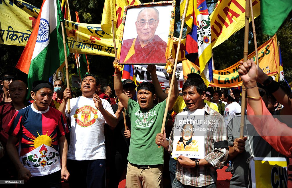 Tibetan exiles residing in India carry a picture of Tibetan spiritual leader, the Dalai Lama, as they participate in a protest rally in New Delhi on March 10, 2013. The protest marked the 54th anniversary of the Tibetan national uprising, the 1959 rebellion against China's rule in Tibet. AFP PHOTO/ Sajjad Hussain