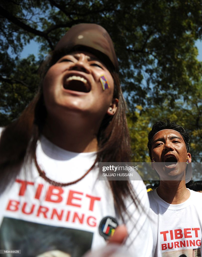Tibetan exiles residing in India shouts slogans as they participate in a protest rally in New Delhi on March 10, 2013. The protest marked the 54th anniversary of the Tibetan national uprising, the 1959 rebellion against China's rule in Tibet. AFP PHOTO/ Sajjad Hussain