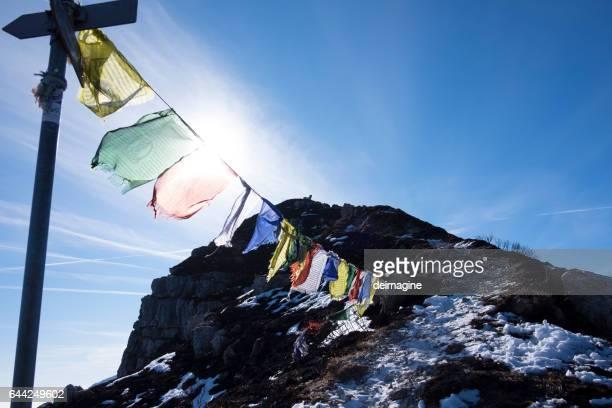 Tibetan flags on mountain summit