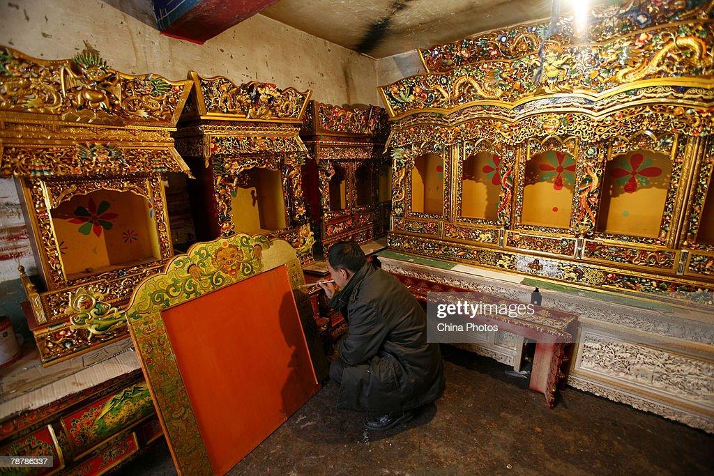 A Tibetan Folk Artist Paints Furniture On January 5, 2008 In Lhasa Of Tibet  Autonomous