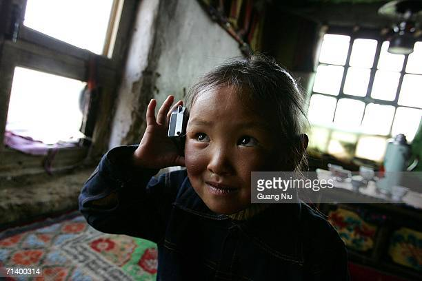 Tibetan girl listens to a radio at her home in a small village in the district of Naqu July 7 2006 in Lhasa Tibetan Autonomous Region China In Naqu a...