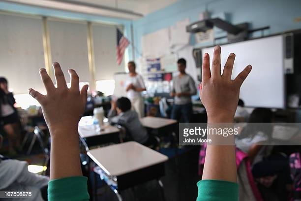 Tibetan immigrant children ask questions during an afterschool program for asylum immigrants run by the International Rescue Committee on April 25...