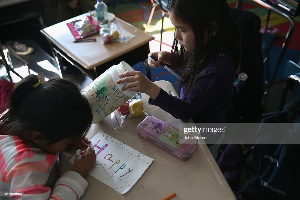 Tibetan immigrant children draw during an after-school program for asylum immigrants run by the International Rescue Committee (IRC), on April 25, 2013 in the Queens borough of New York City. The after-school program held at P.S. 199 consists of homework help and visual art instruction for Tibetan children in grades 2 through 4. The IRC is a non-profit humanitarian aid organization that aids refugees and survivors of international conflict. They assist new arrivals, many of whom come from refugee camps and war zones, to adjust to American society after being granted refugee status and invited by the U.S. government to live in the United States. The IRC also assists refugees through the immigration and naturalization process to become U.S. citizens.