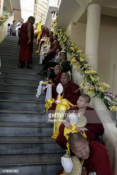 Tibetan in exile sitting with Lord Budha idol as they will offer to Tibetan the spiritual leader the Dalai Lama on his 80th birthday celebration at...