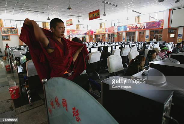 Tibetan lama uses the internet at a huge internet cafe on June 27 2006 in Lhasa Tibetan Autonomous Region China The Chinese economy is booming and...