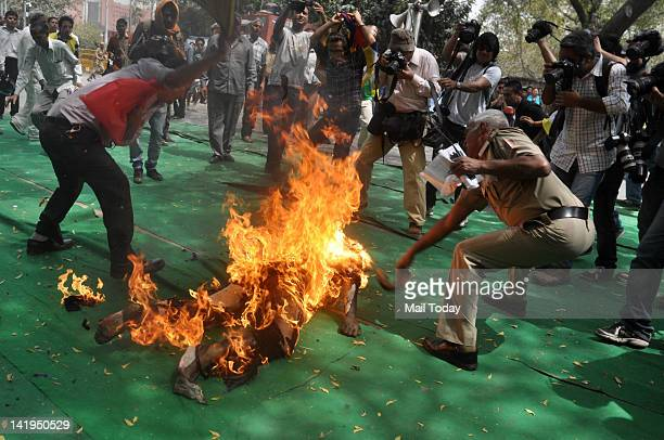Tibetan man screams as he runs engulfed in flames after selfimmolating at a protest in New Delhi India ahead of Chinese President Hu Jintao's visit...