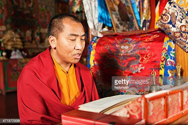 Tibetan monk praying during puja