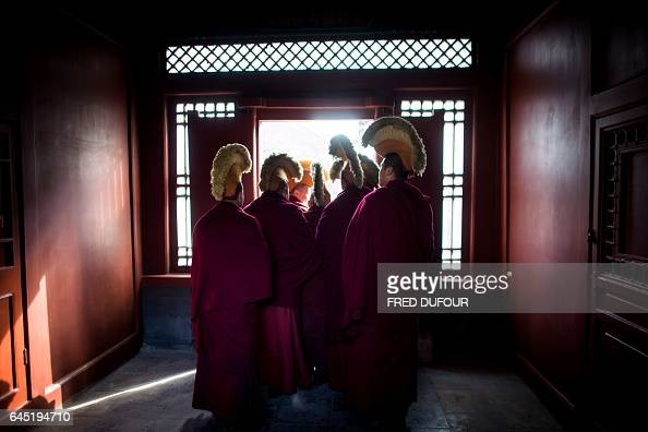 TOPSHOT Tibetan monks attend the Beating Ghost festival at the Yonghe Temple also known as the Lama Temple in Beijing on February 25 2017 The Beating...
