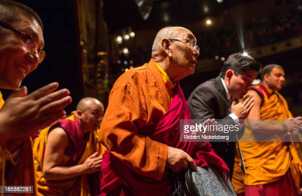 Tibetan monks attending the Dalai Lama teachings bow as His Holiness leaves the stage at the Beacon Theater October 19 2013 in New York City The...