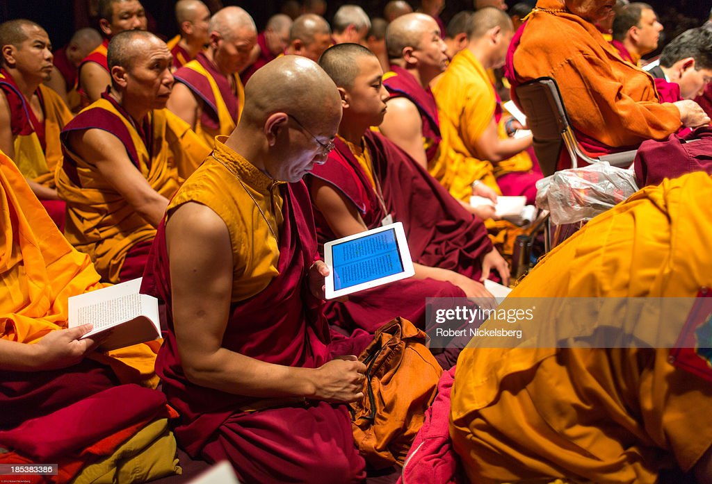 Tibetan monks attending the Dalai Lama teachings follow His Holiness's texts at the Beacon Theater October 19, 2013 in New York City. The Dalai Lama is in New York for three days of Buddhist teachings supported by the Richard Gere Foundation.