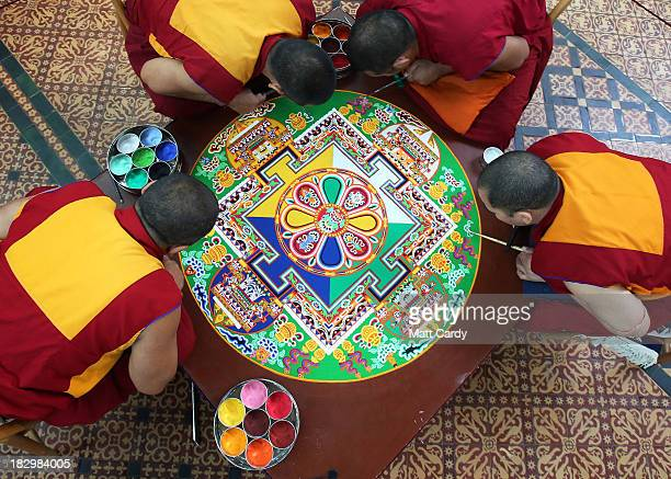 Tibetan Monks from the Tashi Lhunpo Monastery Ven Lobzang Thokmed Kachen Namgyal Kachen Lobzang Tuskhor and Kachen Choedrak complete a Chenrezig Sand...