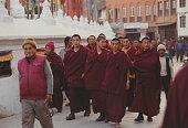 Tibetan Monks Perambulating at Boudhanath in Kathmandu Bordering Tibet and for desperate Tibetan refugees walking distance Nepal and more...