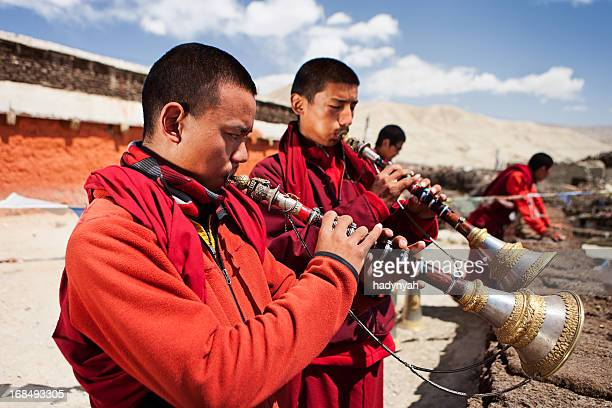 Tibetan monks playing buddhist horns