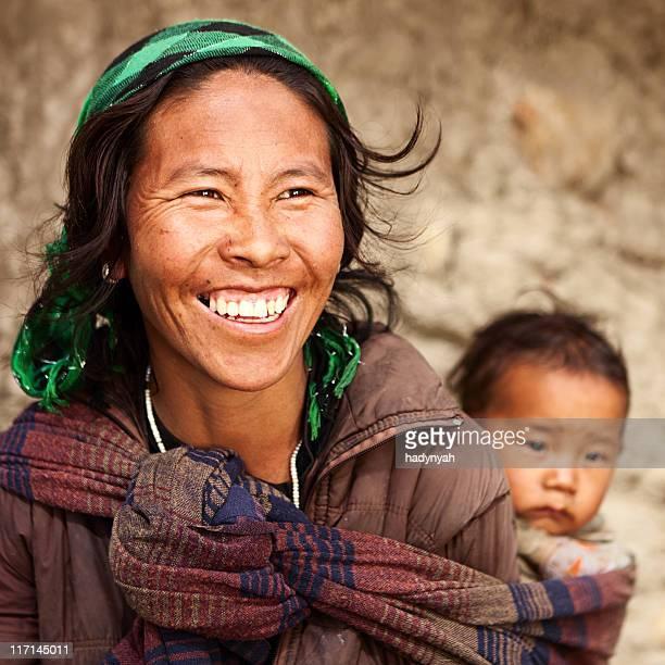 Tibetan mother carrying her child