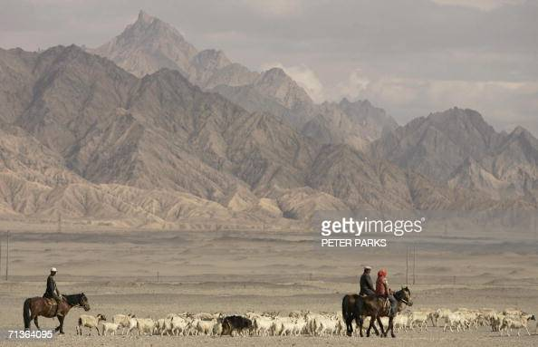 Tibetan nomads herd their sheep on the outskirts of Golmud in China's northwest Qinhai province 03 July 2006 On 06 July China and India will reopen...