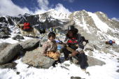 Tibetan nomads rest on their journey to the snowcapped Kangrinboqe Mountain known as Mt Kailash in the West June 16 2007 in Purang County of Tibet...