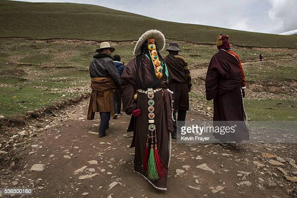 Tibetan nomads take a break from harvesting cordycep fungus on the 15th day of Saka Dawa the holiest day of the Buddhist calendar on May 21 2016 at...