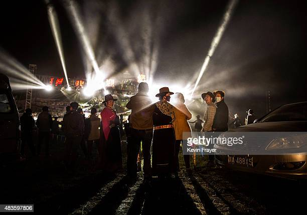 Tibetan nomads watch a laser show at a local festival on July 26 2015 on the Tibetan Plateau in Yushu County Qinghai China Tibetan nomads face many...