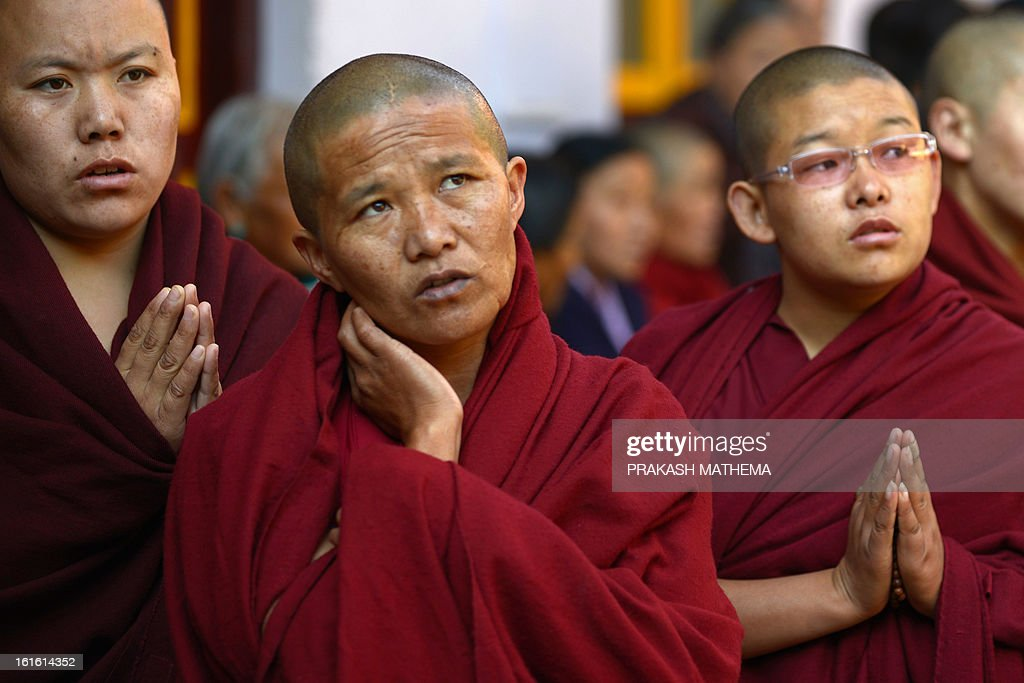 Tibetan nuns in exile observe the third day of Losar, the Tibetan new year, in Kathmandu on February 13, 2013. A Tibetan monk doused himself in petrol in a Kathmandu restaurant on Wednesday and set himself on fire, marking the 100th self-immolation bid in a wave of protests against Chinese rule since 2009. AFP PHOTO/Prakash MATHEMA