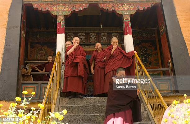 Tibetan nuns laughing  in Lhasa Tibet China