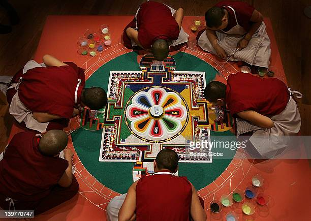 Tibetan nuns make a sand mandala at Davis Museum Wellesley College Tibetan Buddhist nuns from the KeydongThukCheCheLing Nunnery in Kathmandu Nepal...