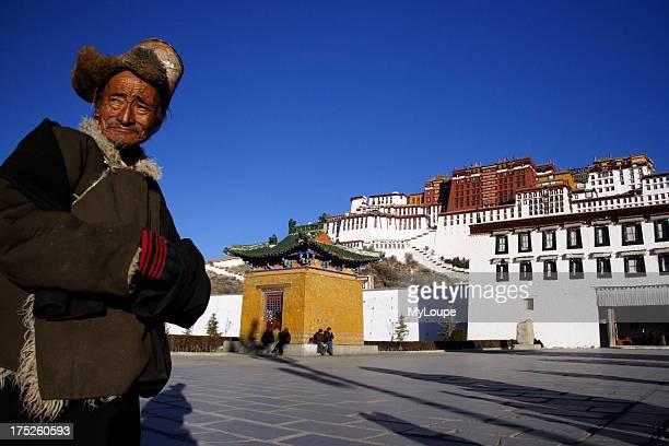 Tibetan pilgrim by Potala PalaceLhasa Tibet