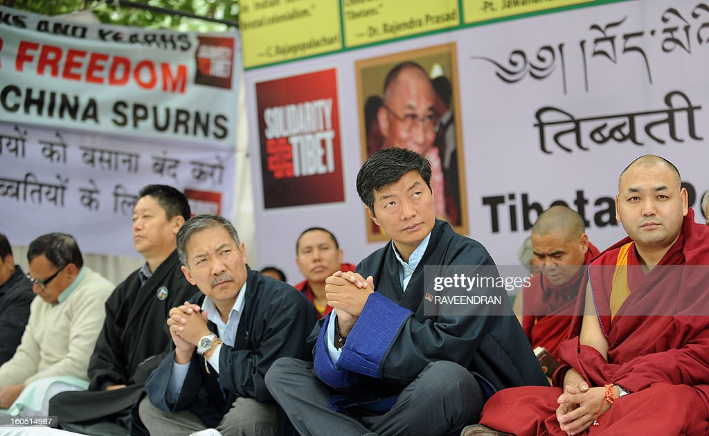 Tibetan Prime Minister Lobsang Sangay (3R) sits with Buddhist monks, nuns and activists during a protest rally in New Delhi on February 2, 2013. The Tibetan government in exile launched a Solidarity with Tibet Campaign 2013, as Tibetans continue to self-immolate calling for freedom in Tibet.
