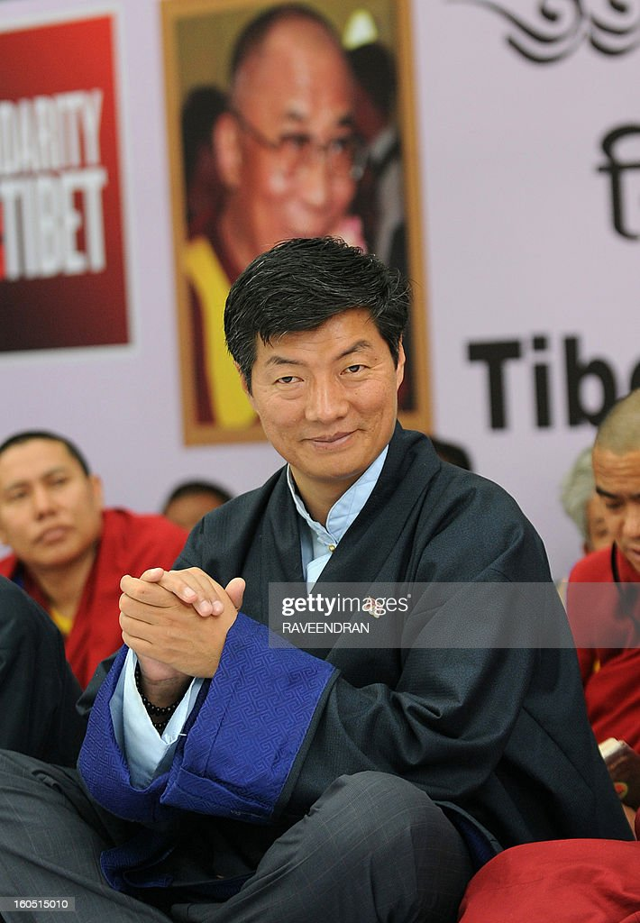 Tibetan Prime Minister Lobsang Sangay (C) sits with Buddhist monks, nuns and activists during a protest rally in New Delhi on February 2, 2013. The Tibetan government in exile launched a Solidarity with Tibet Campaign 2013, as Tibetans continue to self-immolate calling for freedom in Tibet.