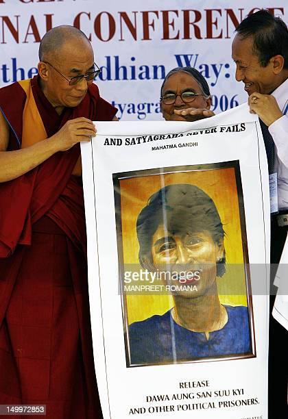 Tibetan spiritual leader and Nobel laureate Dalai Lama releases a poster of Burmese leader Daw Aung San Suu Kyi arrives for Satyagraha Centenary...